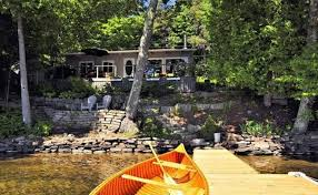 dock and cottage in the background